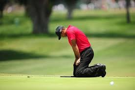 Tiger Woods brought to his knees